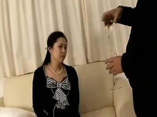 Mature Asian wife lies on..