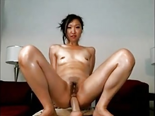 Asian Teen Rides Dildo in..