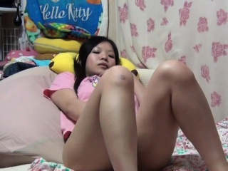 Little asian teen rubbing